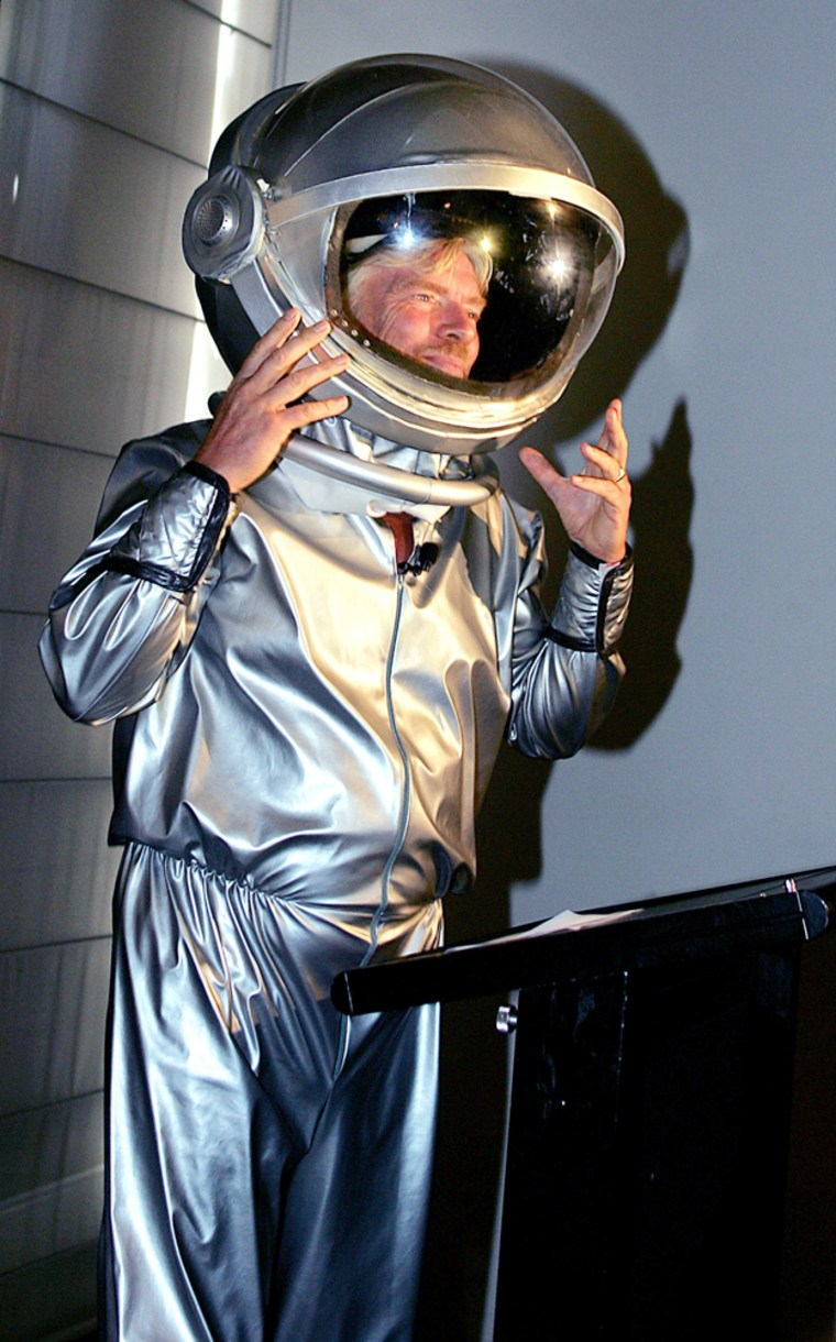 Richard Branson arrives in a space suit