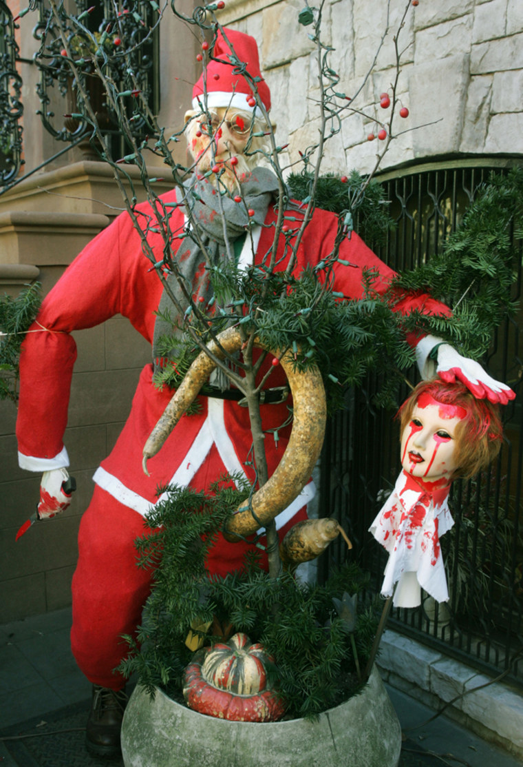 A New York couple's holiday display includes a 5-foot-tall Santa holding a bloody doll's head. The couple says it's a fun way to comment on the commercialization of Christmas.