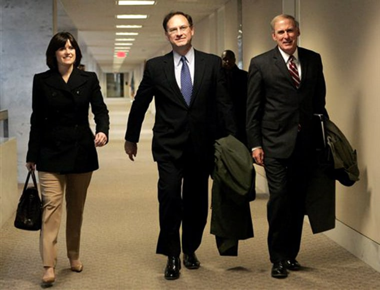 Supreme Court nominee Samuel Alito, center, walksWednesday through theHart Senate Building on Capitol Hill, withtwo associatesfor meetings with senators.