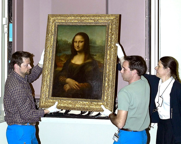 """Museum employees move the Mona Lisa from its former place at Paris' Louvre in April.In a not-completely-serious demonstration, Dutch researchers ran the painting's image through an """"emotion recognition"""" program."""