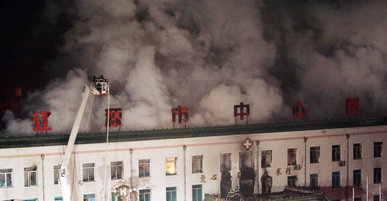 Chinese firemen try to extinguish a fire at Central Hospital in Liaoyuan city