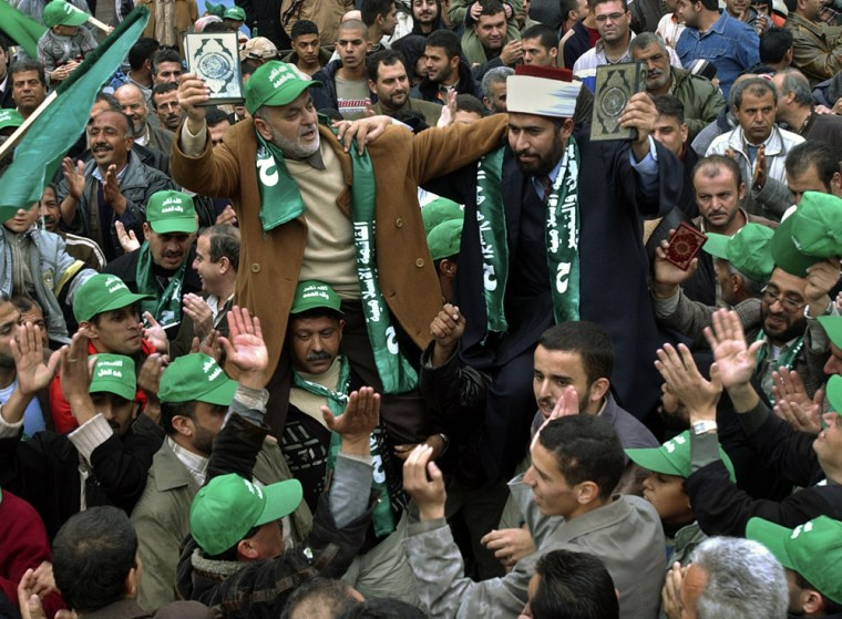 Hamas supporters participate in a rally Friday tocelebrate the group's strong showing in municipal elections in the West Bank town Jenin.