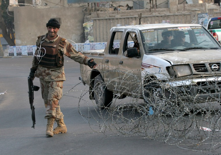 An Iraqi soldier closes off a street in Baghdad on Friday as part of avehicle ban put in place for recent parliamentary elections.