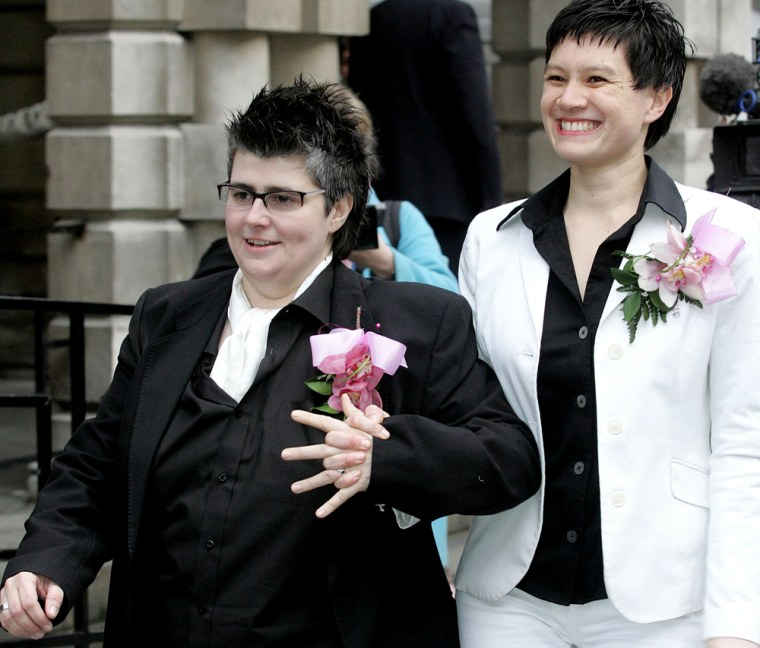 Shannon Sickels, right, and Grainne Close leave Belfast City Hall in Belfast, Northern Ireland, on Monday after becoming the United Kingdom's first gay couple to win legal recognition under a new British civil partnership law.