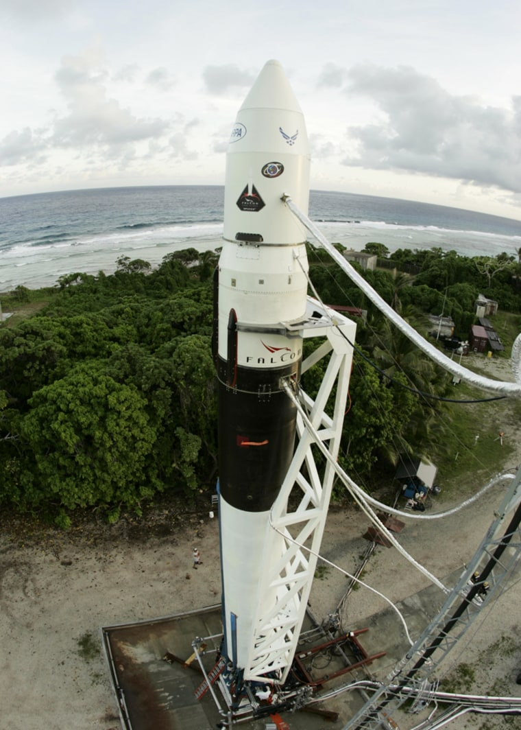 SpaceX's Falcon 1 rocket is readied for launch on its launch pad on a Pacific island.