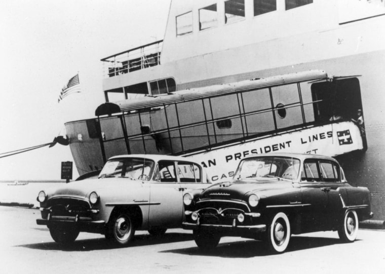 Two Toyopet Crowns, Toyota's first exports to the United States, wait to be loaded on a ship at Yokohama harbor in August 1957. Nearly half a century later, Toyota is on trackto surpass General Motors as the world's No. 1 automaker.