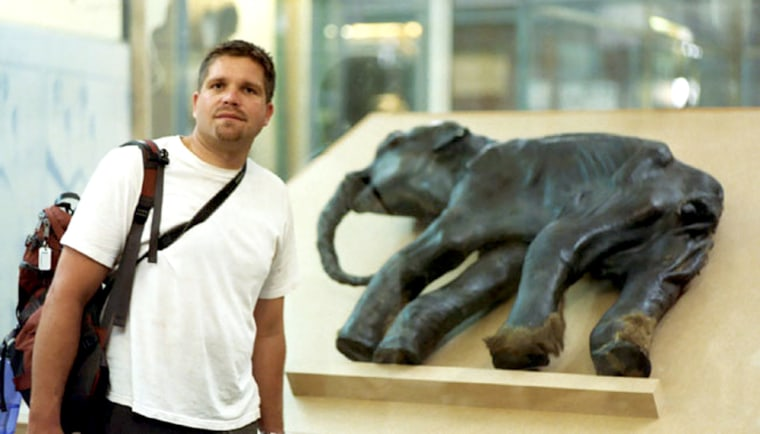 Hendrik Poinar, a geneticist with McMaster University, has sequenced a portion of the genome from a woolly mammoth. Poinar is pictured with the remains of Dima, a baby woolly mammoth unearthed in 1977.