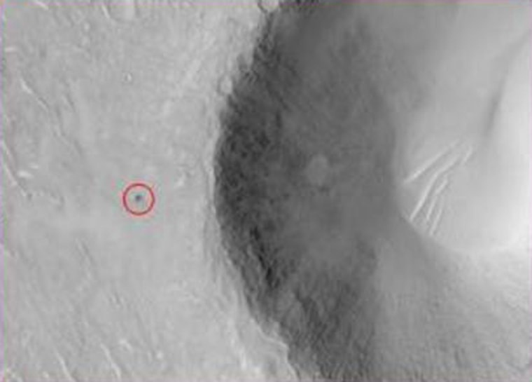 An image from the Mars Global Surveyor orbiter pinpoints a small crater, shown within the red circle, that scientists believe could be the final resting place of the Beagle 2 lander.