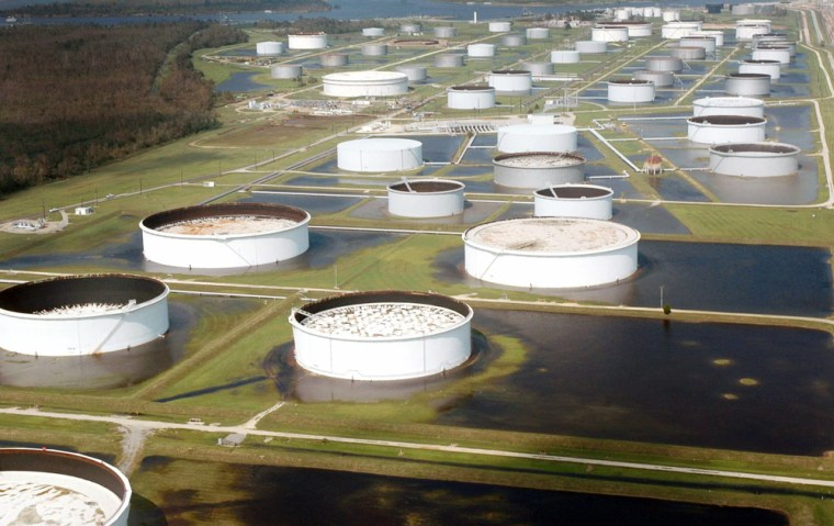 Oil storage tanks of refinery in Texas are surrounded by flood waters caused by Hurricane Rita