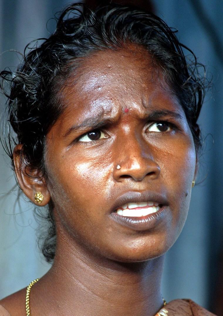 Geetha, an Indian fisherwoman, looks on in Nagapattinam district