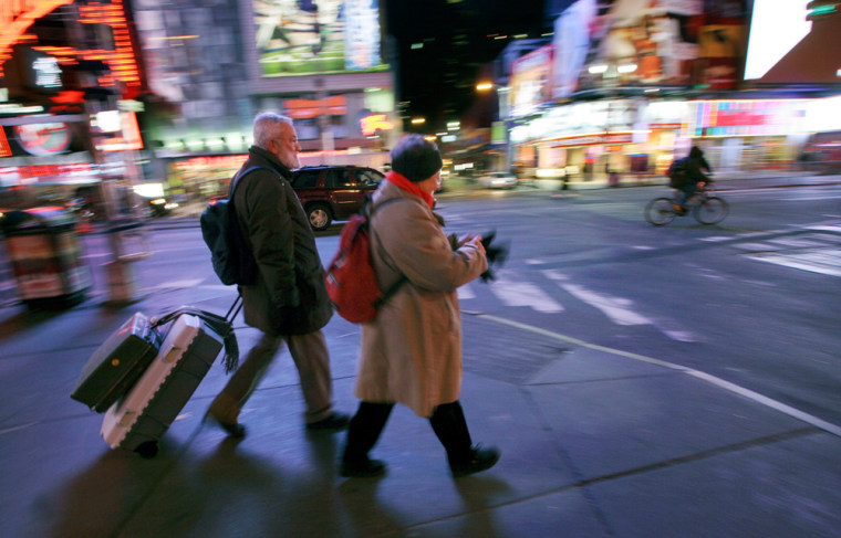 Paul Leendertz, and his wife Felice, of Wageningen, Holland, walk through New York's Times Square, on Wednesday,as the transitstrike enters its second day.