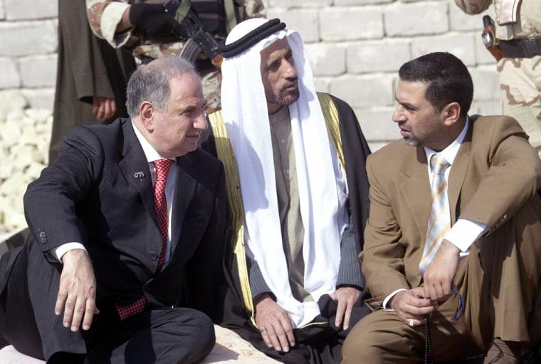 Iraq's Deputy PM Ahmad Chalabi talks to his aides in Basra