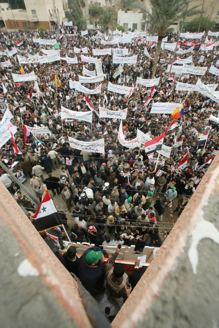Iraqis demonstrate outside the Omar al-M
