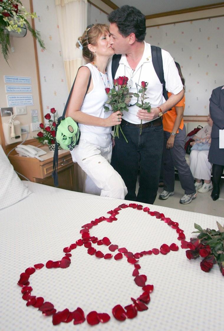 Israelis Bombiger and Nitzan kiss in a hospital room in Phuket