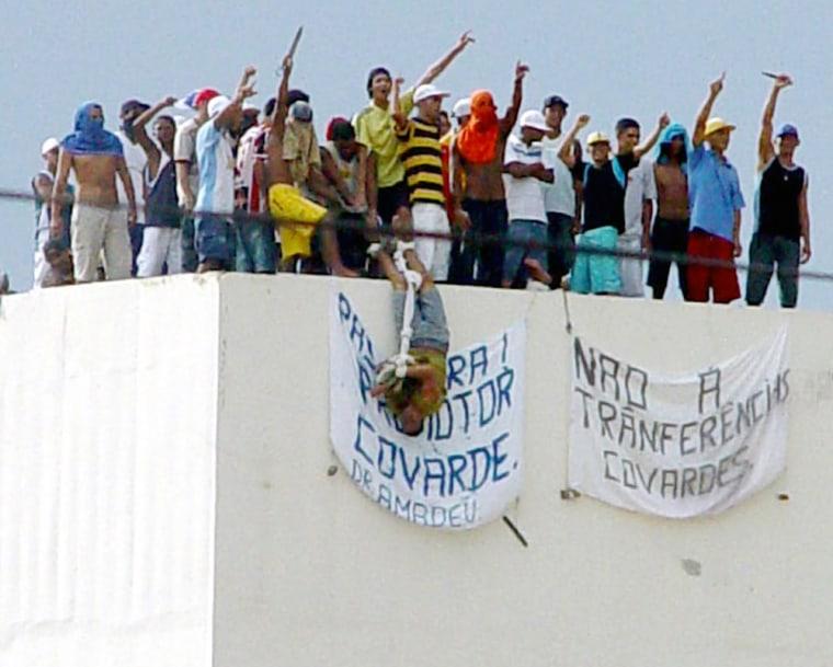 Rioting prisoners shows a hostage at the Urso Branco Penitentiary complex near the Rondonia state capital of Porto Velho
