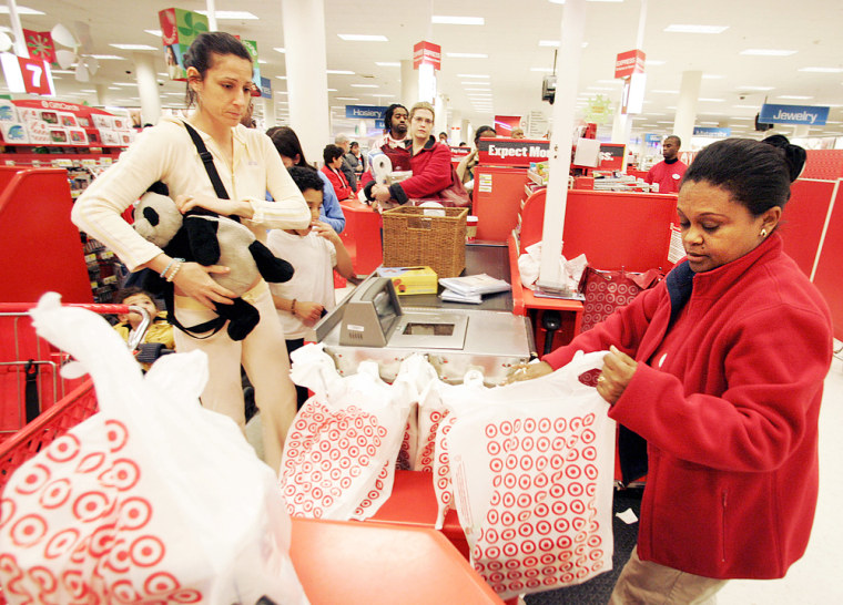 Retailers are on track to meet their modest holiday sales expectations thanks to a flurry of last-minute shoppers, reports show.