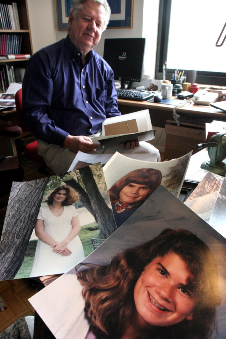 Robert Weissberg pauses as he looks for photographs of his daughter Nicole, 27, as several he has already found, lay on the desk next to him last week in his apartment in New York. Weissberg's 27 daughter, a University of Denver student, was killed a year ago in the Dec. 26 tsunami during a trip to Southeast Asia.