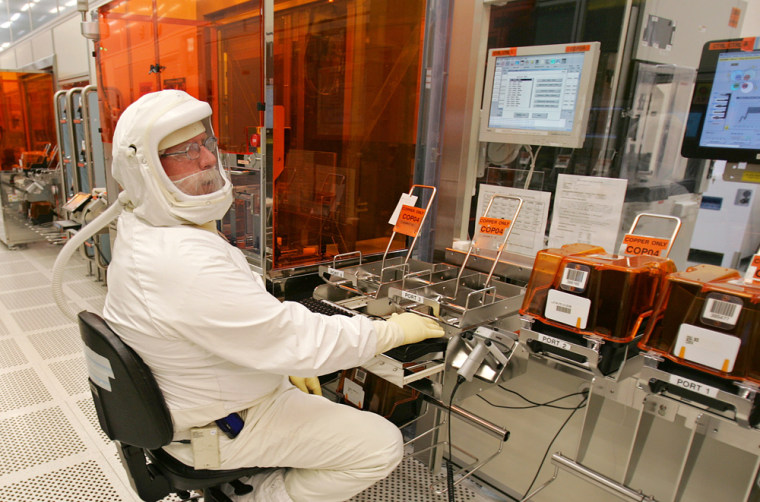 An Intel Corp. manufacturing technician producescomputer chips in a clean room at Intel headquarters in Santa Clara, Calif., earleir this year. Instead of remaining focused on PCs, Intelis pushingto play a key technological role in a half-dozen fields, including consumer electronics, wireless communications, and health care.