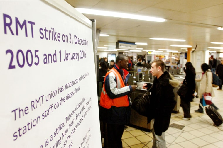 A sign at Victoria underground Station in London warns passengers of possible disruption to services Saturday. Hundreds of thousands of London's New Year's Eve revelers faced transport chaos on Saturday as underground rail station staff staged a 24-hour strike on one of the busiest nights of the year.