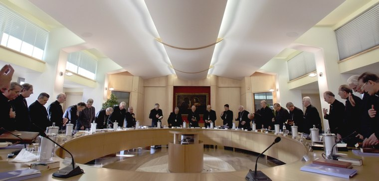 Cardinal Camillo Ruini, at center, prays with other prelates Monday at a meeting of the CEI Italian Episcopal Conference in Rome.