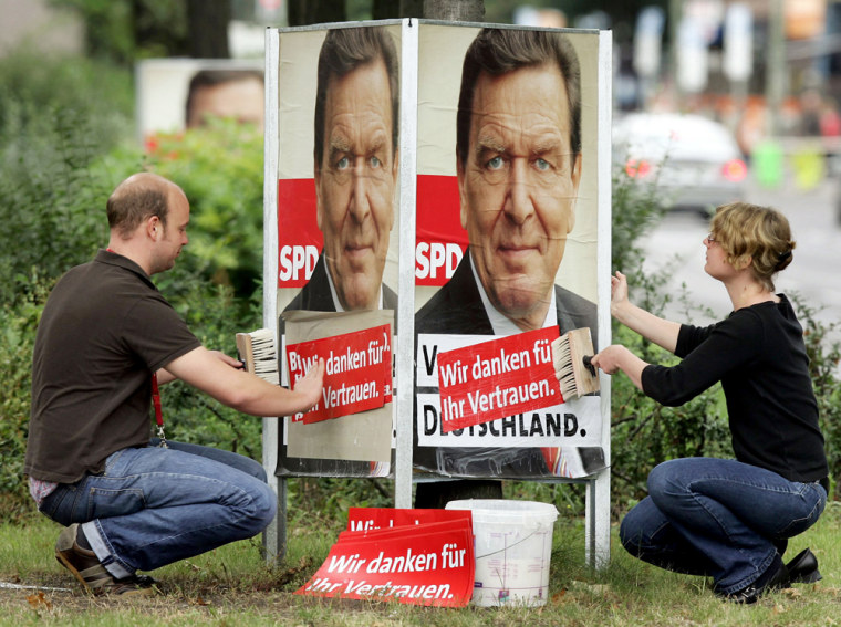 Supporters of German Chancellor Gerhard
