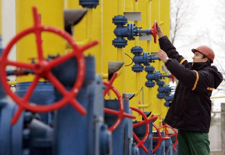 Ukrainian worker operates valves at main pipeline in village of Boyarka near capital Kiev