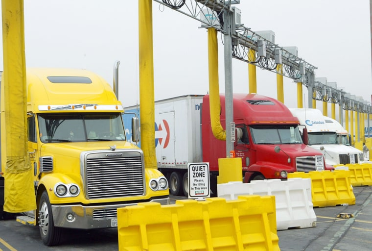 Long yellow hoses deliver the IdleAire Technologies system into rigs at a truck stop in Knoxville, Tenn. The systems provide heat, air conditioning, TV and Internet access to truckers who can rest with their engines off.