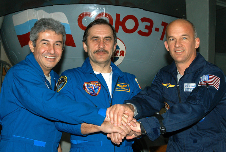 Astronaut Pontes of Brazil, cosmonaut Vinogradov of Russia and astronaut Williams of US pose during their training session in Star City outside Moscow