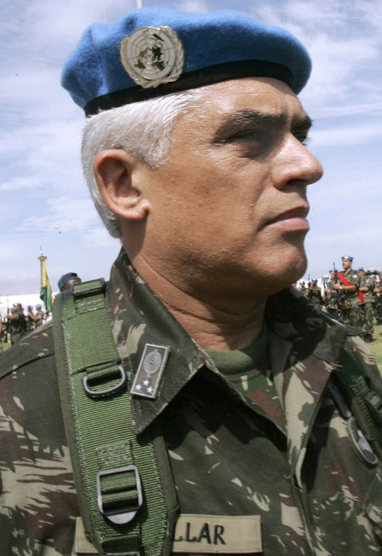 Brazilian Army Gen. Urano Teixeira da Mata Bacellar marches in front of troops during a ceremony marking power transition of the Brazilian UN Commander in Port-au-Prince, Haiti, in thisAug. 31, 2005 file photo.