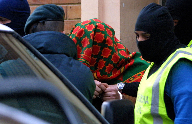Spanish policearrest one of 20 people suspected of recruiting fighters and raising money for the Iraqi insurgency in Vilanova i la Geltru, Spain on Tuesday.