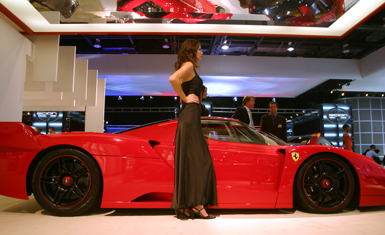Model Yuliya poses next to a $2 million Ferrari FXX. It's hard on her feet, she says, but standing next to a big Ferrari's worth it.