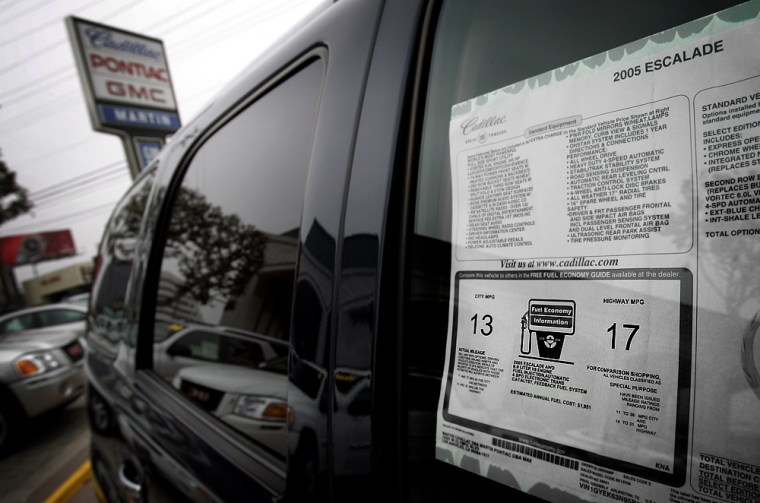 Common to every new car buyer, fuel economy stickers like this one on a 2005 Cadillac Escalade SUV are likely to be overhauled under an EPA proposal to make the estimates more realistic.