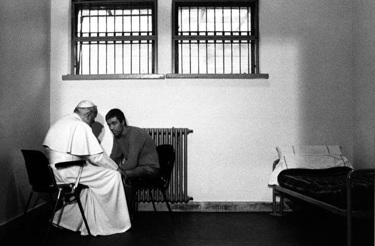 File photo of Pope John Paul II talking with Turkish gunman Agca in a cell of Rome's Rebibbia prison