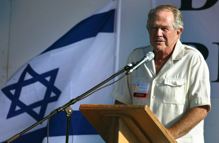 Televangelist Pat Robertson, backed by an Israeli flag, speaks to evangelical Christians during a pilgrimage to Israel in October 2004. His comments about the cause of Prime Minister Ariel Sharon's stroke have drawnwidespread condemnation byother Christian leaders.