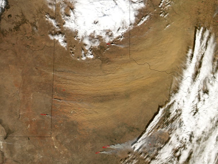 This satellite photo shows a huge dust storm blowing east from northern Texas and into Oklahoma on Jan. 1.