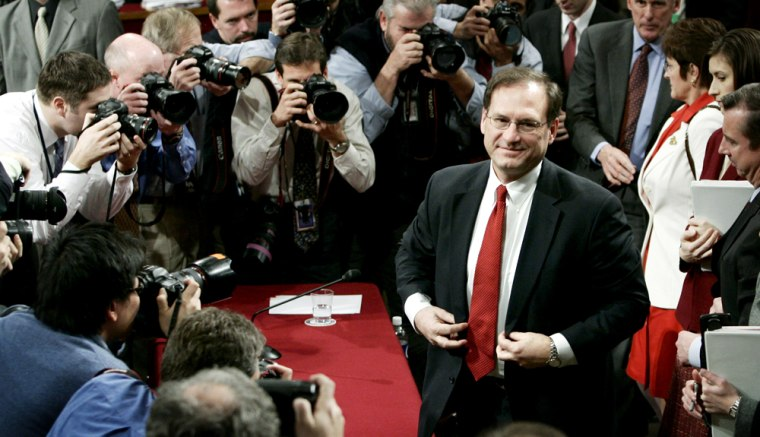 U.S. Supreme Court nominee Samuel Alito leaves the hearing room on the final day of public testimony in Washington