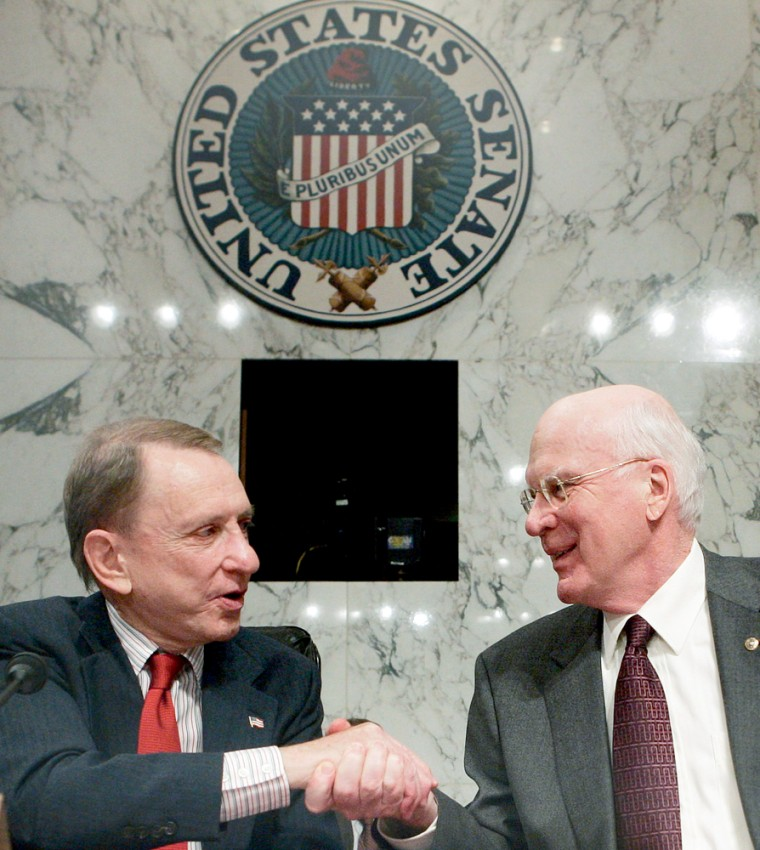 US Judiciary Committee Chairman Specter shakes hands with Leahy at conclusion of hearings on Capitol Hill in Washington