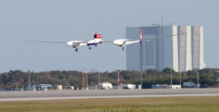 The Virgin Atlantic Global Flyer aircraftdescends toKennedy Space Center's Shuttle Landing Facilityin Florida during the buildup to last month's round-the-world flight. The arrangements for Global Flyer could serve as a model for future private use of the airstrip.