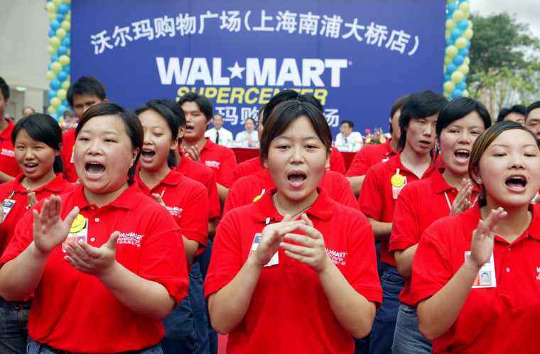Chinese staff sing during the opening ce