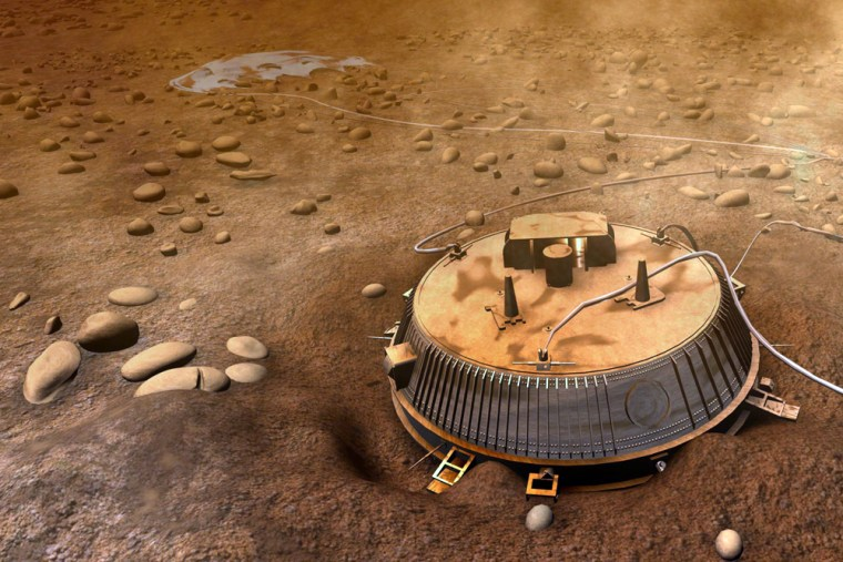 """Asimulated camera looks back at the Huygens lander on the surface of Titan in a """"virtual tour"""" based on data sent back by Huygens itself."""
