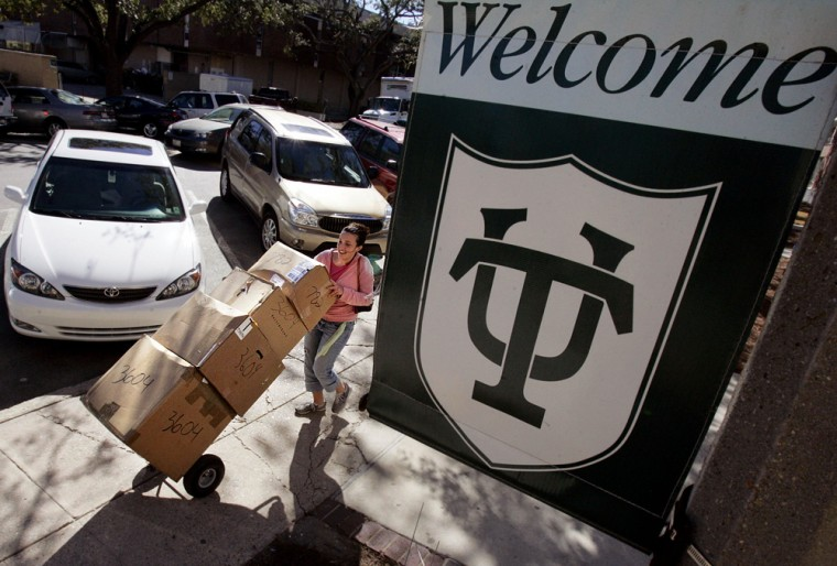 College student hauls boxes of clothes across campus to her dormitory in New Orleans