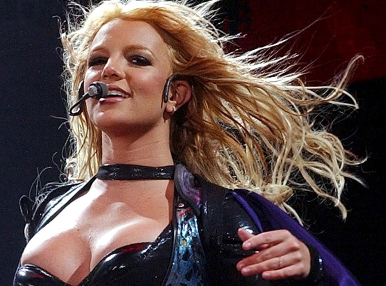 **FILE** Britney Spears  performs in Zurich, Switzerland, on May 20, 2004.  The new mom is No. 1 on Yahoo's annual list of the most-searched for terms on the Internet in 2005.  Spears has topped the list for three of the last four years.(AP Photo/Keystone, Dorothea Mueller)