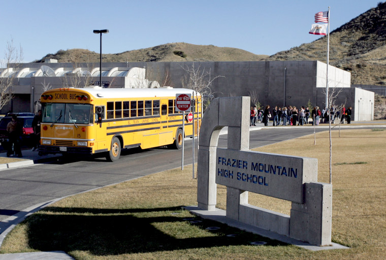 """A school bus leaves Frazier Mountain High School in Lebec, Calif.. where a """"Philosophy of Design"""" class had addressed a religion-based alternative to the scientific theory of evolution."""