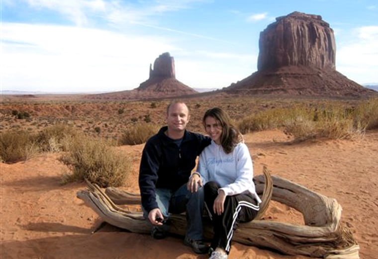 Rudolf de Haan, left, and Caroline Bussey on Nov. 23, 2005, with the Left and Right Mittens in Monument Valley Navajo Tribal Park, Ariz., while on a Contiki tour. The couple met in 2004 on a Contiki tour in Europe.