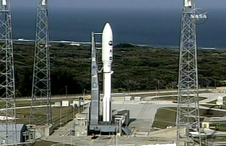 The New Horizonsspacecraft sits atop an Atlas 5 launch vehicle on the launch pad in Cape Canaveral, Fla., on Tuesday.