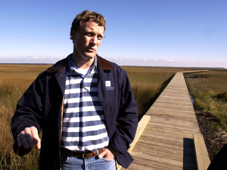 Michael DeMell, environmental consultant to Cumberland Harbour development, stands on a newly constructed dock that comes offa deep water lot in St. Marys, Ga.The marina and housing development takes up part of a peninsula frequented by northern right whales.