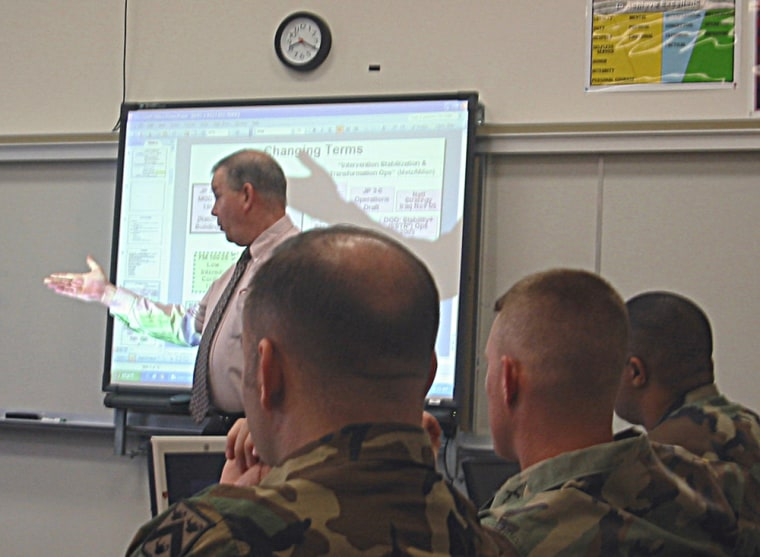 At the Command and General Staff College, in Forth Leavenworth, Kansas, Army instructor Stuart Lyon teaches a seminar on the theory of counterinsurgency.
