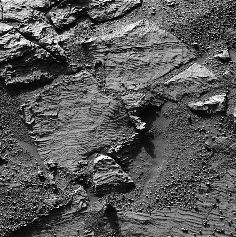 """Opportunity on Thursday drove about 7.8 feet towarda rock dubbed """"Overgaard,"""" which it snapped this picture of earlier in the month."""