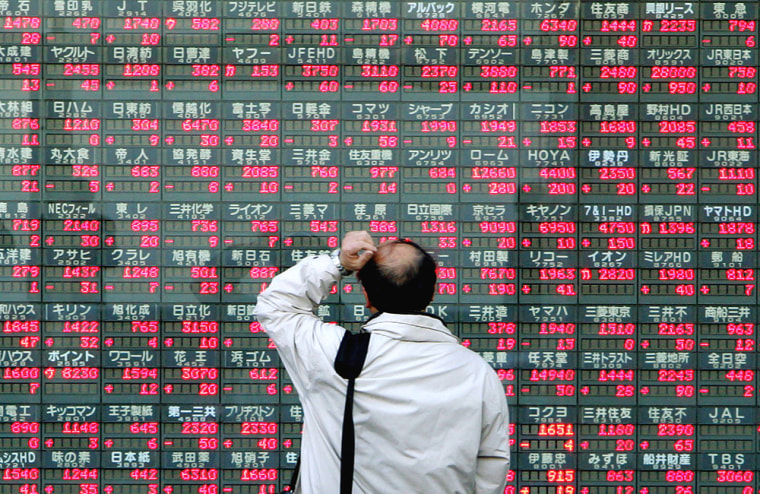 A man looks at an electronic stock quota