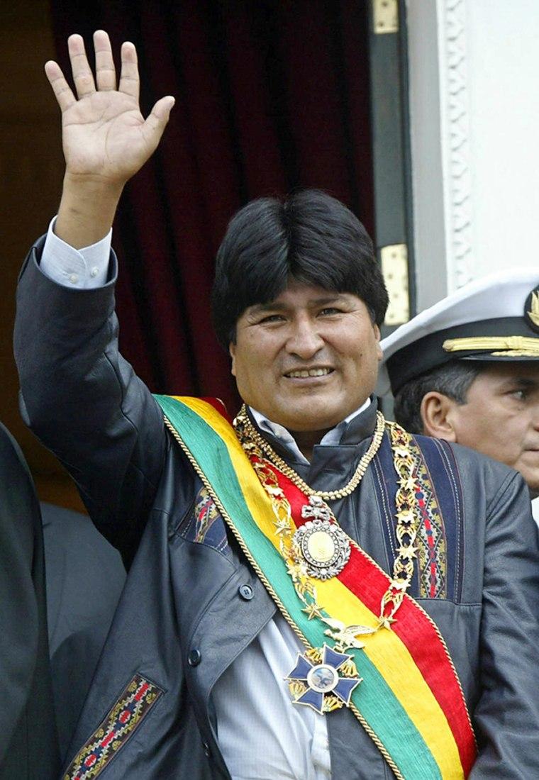 New bolivian president Evo Morales waves